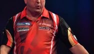 Darts fairytale victory: Forty to one outsider Mensur Suljovic pulls off a shock to win Champions League Crown